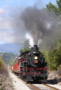 #7470, an ex Grand Trunk and ex Canadian National 1921 0-6-0 steam engine returns from Bartlett climbing the steep hill at Intervale with Mount Washington in the background, 9-18-10