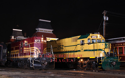 Old Friends Reunited, GP-7 #573 and GP-38 #252, both former Maine Central locomotives sit together outside North Conway Depot. #573 has been with the CSRR for sometime, but #252 is a recent addition. Lighting is lumedyne, 9-18-10.