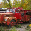 A former Springfield, MA Maxim S Model pumper sits rotting away in a yard next to the tracks in Chester, CT.