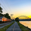 The Dinner Train at sunset in Bourne with the Bourne Bridge and Cape Cod Canal in the background, 7-13-19.
