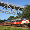 The Dinner Train skirts along Cape Cod Canal passing under the Bourne Bridge, 7-13-19.
