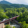 "On the return trip from Walton NS 958 ""The Pocahontas"" lead by the infamous 611 crosses the bridge over the Roanoke River in Wabun, 5-27-17."