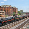 """N&W 611 brings """"The Powhatan Arrow"""" into Roanoke with the original Norfolk & Western headquarters building (now apartments) in the background. The construction in the foreground is progress on the new Roanoke Amtrak Station which if happens as planned will restore passenger service to Roanoke, 5-27-17."""