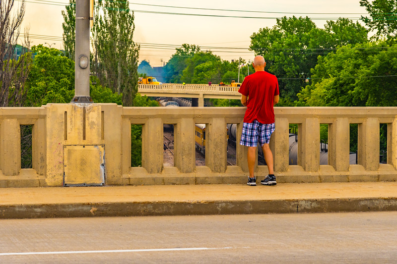 """One guy on the """"downstream"""" side of the bridge photographing UP 4014's departure to the East."""