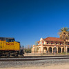 <h3>MOW train passes the beautifully restored UP station at Kelso, CA. The station is now the headquarters for the Mojave Desert Preserve and serves as a railroad museum.