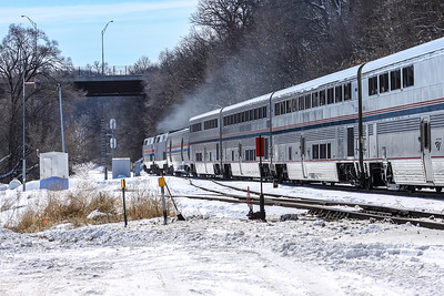 Amtrak Heritage unit #130 and companion unit accerates out of Omaha, NE towards Chicago.