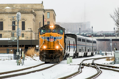 UP4832 leads a very late Amtrak #6, California Zephyr, from Omaha, NE enroute to Chicago, IL.  The old train station, now home to KETV-7, stands over the current Amtrak station.