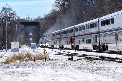 Amtrak Heritage unit #130 and companion unit accerates out of Omaha, NE towards Chicago.