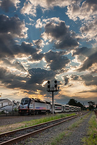 Bound Brook Sunrise An eastbound NJ Transit commuter train departs Bound Brook station heading for Newark Penn under a cloud-littered sunrise.