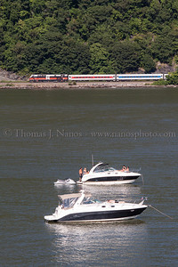 Heritage along the Hudson CDOT New Haven painted P32AC-DM #231 powers a MetroNorth train southbound along the Hudson River near Bear Mountain, NY, as a pair of boats enjoy the last weekend of August.