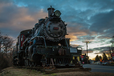 The Colors at Essex Valley Railroad veteran No 97 sits quietly on the display track while she awaits rebuilding in the near future.  As a backdrop to the locomotive is a very colorful sunset.