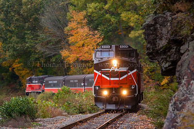 Fall Foliage Excursion The Mass Bay RRE Willimantic Special on the Providence & Worcester Railroad is rolling west towards Willimantic, just clearing the rock cut at Scotland Dam in Windham, CT