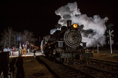 North Pole Express #2 The Valley Railroad's North Pole Express runs in two sections each night.  Here train #2, with Valley veteran No 40 in charge, arrives in Deep River to pick up Santa and his elves for the train ride.  Three flashes light up the scene.