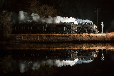Pratt Cove Reflection A Valley Railroad North Pole Express passes by a very calm Pratt Cove in Deep River, CT