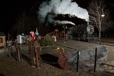 Now Arriving at the North Pole Santa and Mrs. Claus greet the families as they arrive at the North Pole on the Valley Railroad