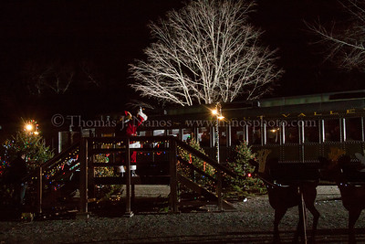 "The Jolly Old Elf Santa Claus greeting the arriving families at the ""North Pole"" station in Deep River, CT."