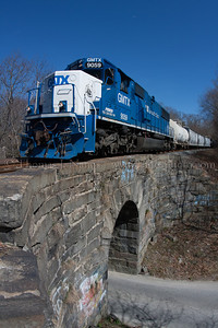 Over the Arch A Providence & Worcester extra to Willimantic, CT heads over Kinsman Hill Road in Versailles, CT on the P&W's Willimantic Branch on 3/30/12