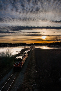 Sunset over Clayville Pond Providence & Worcester train NR-2 northbound past Clayville Pond in Griswold, CT.