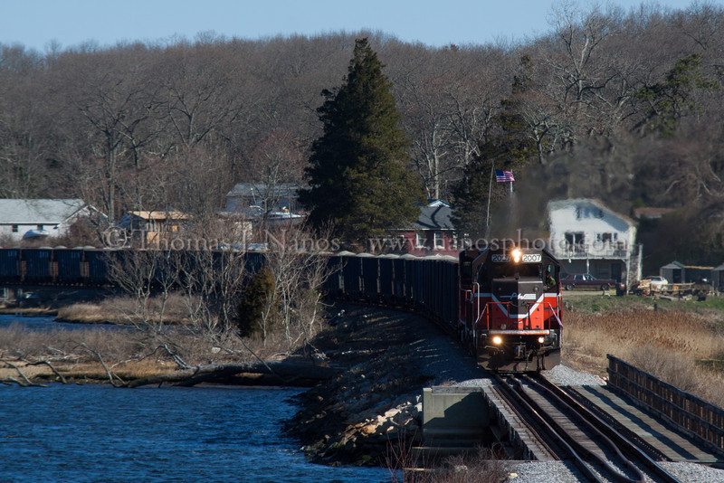 P&W in Preston Providence & Worcester train NR-2 heads south along the Thames River in Preston, CT on a cold, blustery January, er, I mean late March morning.  The train is about to cross over the inlet to Poquetanuck Cove and enter the town of Ledyard.