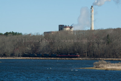 NR-2 in Preston Providence & Worcester train NR-2 skirts along the Thames River in Preston, CT on a blustery, cold late March morning.