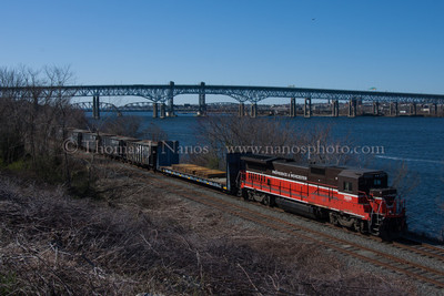 NR-2 and two bridges The tail end of Providence & Worcester train NR-2 rolls through Fairview Yard in Groton, CT with the I-95 Gold Star Bridge and Amtrak Thames River lift bridge in the background.
