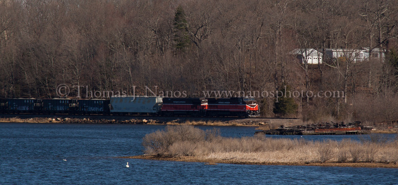 NR-2 along the Thames Providence & Worcester train NR-2 heads south in Preston, CT along the Thames River past a sunken barge.