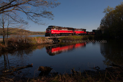 Reflections of NR-2 Providence & Worcester train NR-2 heads south through Ledyard, CT past a calm tidal pool.