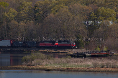 NR-2 in Preston Providence & Worcester train NR-2 heads south along the Thames River in Preston, CT past a sunken barge.