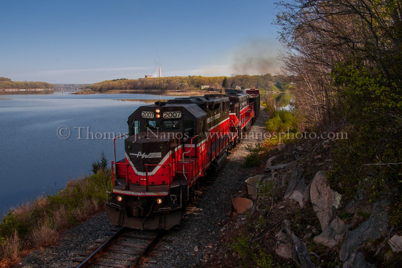 P&W NR-2 along the Thames Providence & Worcester train NR-2 rolls south along the Thames River - the front half in Ledyard, CT, the rear in Preston.  Visible in the distant background is the Mohegan-Pequot bridge carrying Route 2A over the Thames River between Uncasville and Preston.
