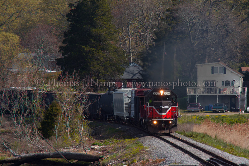 NR-2 past MP8 in Preston Providence & Worcester train NR-2 heads south along the Thames River in Preston, CT past milepost 8