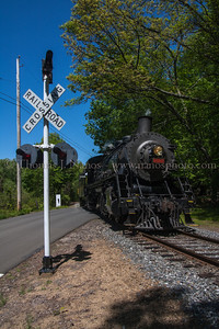 Over the Crossing Valley Railroad No 3025 pulls their train over the Old Deep River Road crossing in the Centerbrook section of Essex, CT