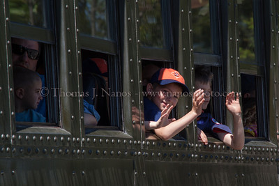 Happy Cub Scouts A troop of Cub Scouts waves out of the window of one of the coaches