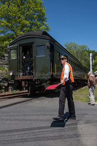 Chris at the Crossing Valley Railroad Conductor Chris flags the crossing at Deep River Landing as the train shoves into the siding.