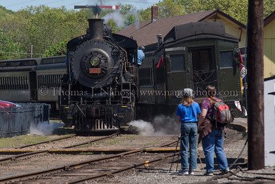 Railfans filming A pair of railfans watch 3025 pass by her train on the first day of the 2012 season