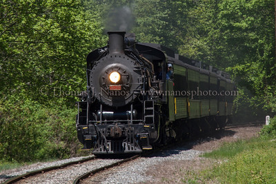 Passing Milepost 5 Mikado No 3025 pulls the train south past milepost 5 in the Centerbrook section of Essex, CT