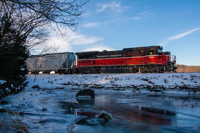 Cold Morning at the Cove III The tail end of Providence & Worcester train NR-2 passes by the southwestern corner of Poquetanuck Cove in Ledyard, CT, on a cold January morning.