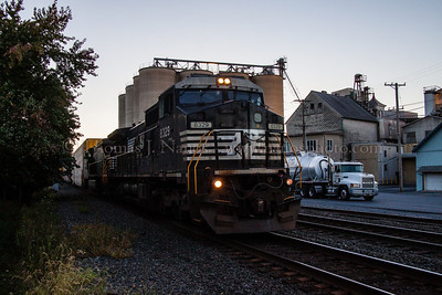 Norfolk Southern train 290 passes by the grain mill at Fleetwood, PA close to sunset.