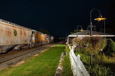 Norfolk Southern train 15T passes by the pavilion and garden at Macungie, PA