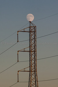 The moon rises above a power transmission tower in Bound Brook, NJ