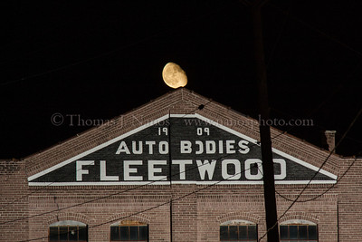 The Moon rises over the former Fleetwood auto body plant in Fleetwood, PA.