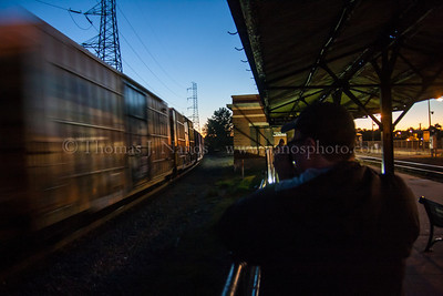 Photographer Bill Willis gets his shot of a passing Norfolk Southern freight at Bound Brook, NJ