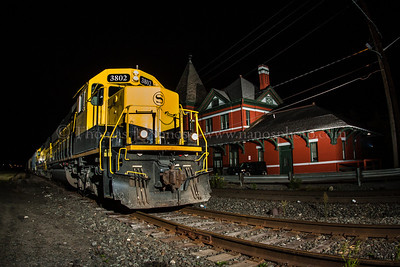 New York, Susquehanna & Western train SU100 passes by the former Erie station at Port Jervis, NY.  Taken just before midnight on September 15, 2013.