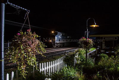 Norfolk Southern train 25V passes by the pavilion and garden at Macungie, PA.