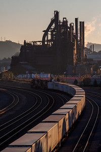 On a crisp fall morning, Norfolk Southern train 262 pulls into Bethlehem, PA just after sunrise, as the former Bethehem Steel blast furnaces make an interesting backdrop.  October 25, 2013