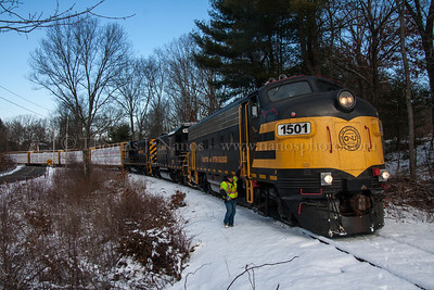 The conductor of Grafton & Upton Railroad train GU-1 hops off to flag a crossing in Grafton, MA