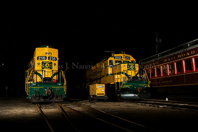 Conway Scenic locomotives 216 and 252 wait quietly in the railroad