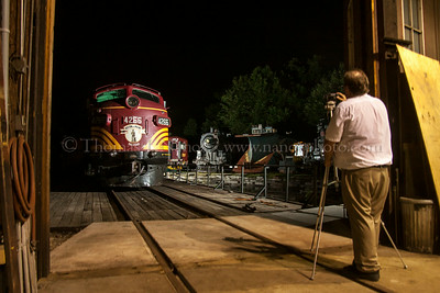 Photographer Bill Willis gets his shot of the Conway Scenic power at the North Conway roundhouse and turntable