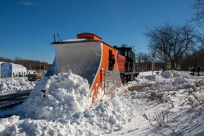 Shoving snow across a grade crossing at Deep River Landing