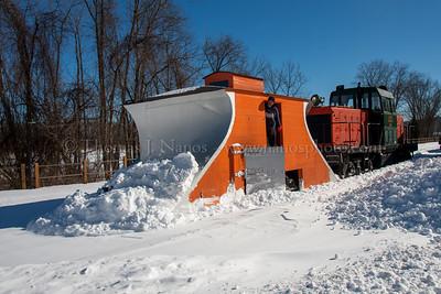The plow shoves snow through Deep River yard