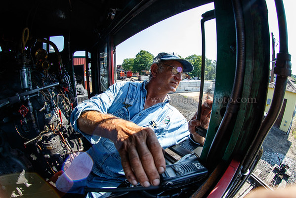 Fred adjusts the volume on his handheld radio as he watches for the fireman